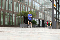 Germany, Cologne, Young man and women jogging