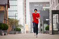 Germany, Cologne, Young man jogging