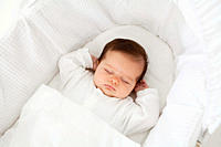 Baby sleeping in a bassinet