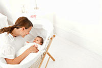 Mother with baby in bassinet
