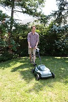 Man mowing grass with lawnmower
