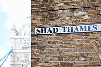 Shad Thames sign and Tower bridge, London