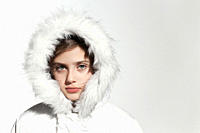 Girl wearing a white coat with fur hood
