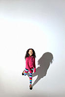 Girl standing on one leg with shadow