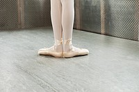 Feet of ballerina in first position