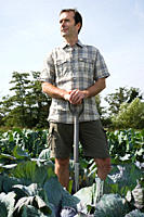 Man standing in cabbage field (thumbnail)