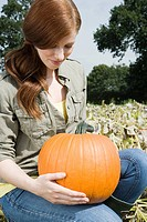 Young woman with a pumpkin