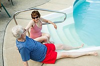 Senior couple by swimming pool