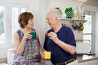 Senior couple having hot drink