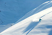 Austria, Woman skiing on snow covered arlberg mountain