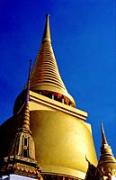 A golden spire, at the Temple of the Emerald Buddha, Bangkok Thailand