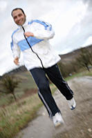 Young man jogging in spite of bad weather