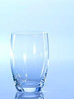 Empty glass against blue background, close_up