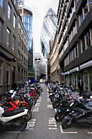 Swiss Re Tower and parked motorbikes London