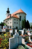 Graveyard and traditional church in the village of Ising in Bavaria, Germany