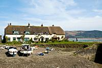 PORLOCK WEIR SOMERSET Boat beached Porlock Weir Harbour and thatched cottages