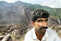 A man after the earthquake  An earthquake hit Pakistan in October 2005, destroying hundreds of villages and claiming thousands of lives  Emergency rel...