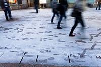 Step marks on freshly snow-covered street. Rijeka, Croatia.