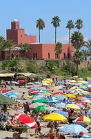 Beach and Bil-Bil castle in background, Benalmadena, Costa del Sol, Malaga province, Andalusia, Spain