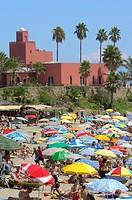 Beach and Bil-Bil castle in background, Benalmadena, Costa del Sol, Malaga province, Andalusia, Spain