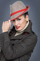 Young woman wearing jacket and fedora