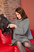Young woman emptying purse