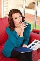 Young woman holding color swatch