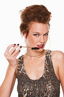 Young woman eating caviar (thumbnail)