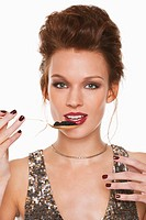 Young woman eating caviar