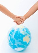 Holding hands and a globe