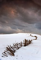 A Broken Fence Along A Snow Covered Field With Dark Clouds Overhead, South Shields, Tyne And Wear, England