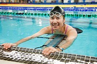 a paraplegic woman swims in a pool, edmonton, alberta, canada