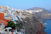 Whitewashed houses on top of the cliff  Port with the ferry in Oia village, Santorini