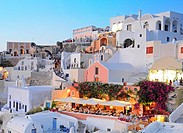 Oia village restaurant and houses at sunset