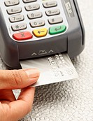 Hand inserting credit card into machine