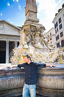 Young man at fountain in Rome, Italy