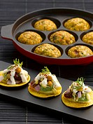 Indian snacks: sev puri biscuits topped with vegetables and paniyaram deep_fried lentil balls
