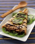 Pancake with melted chocolate and kiwi (thumbnail)