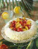 Coconut crown cake filled with fresh fruit