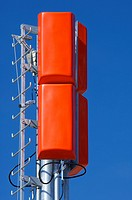 closeup of a television and radio repeater with a clear blue sky