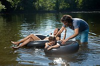 Couple and daughter having fun in lake