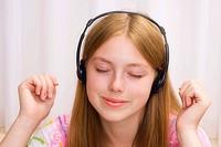 Girl, 17 years, with headphones