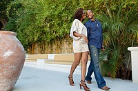 Young couple walking on patio
