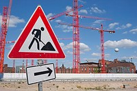 Construction site warning sign in front of construction cranes in the new development area of HafenCity, Hamburg, Germany, Europe