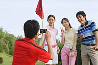 Man Taking A Picture On Golf Course
