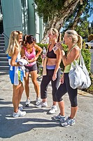 Attired for an excercise session, four athletic woman meet outside a gymnasium in Laguna Niguel, CA  Note Hispanic in center