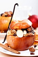 Baked apple with nuts, raisins and cinnamon
