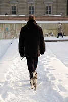 Man walking his dog in winter