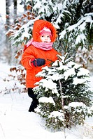 Little girl in a snowy forest