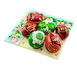Group of painted Easter eggs on colored napkin isolated